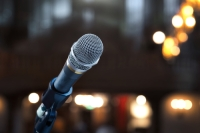 Close up of microphone 1n concert hall or conference room